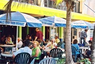 Street side tables at Cha Cha Coconuts on St Armands Circle Sarasota Florida