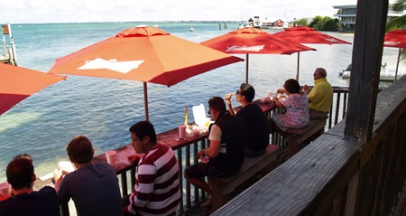 One of the decks at New Pass Grill Sarasota's City Island Restaurant