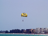 parasailing over the Gulf of Mexico beaches in Sarasota Florida