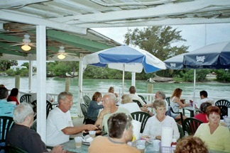 A dining area at Pops Sunset Grill Nokomis Florida