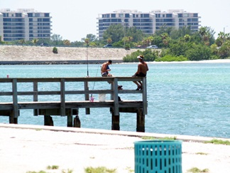 Fishing off the pier at Ken Thomson Park on City Island