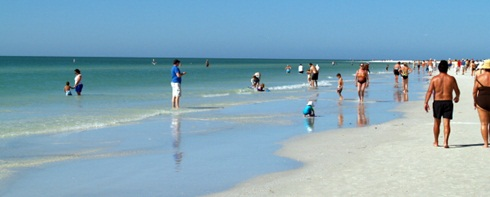 People walking the shore on Siesta Key Beach