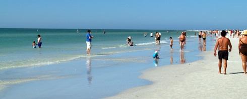 People walking the shore on Siesta Key Beach