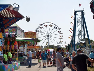 A carnival midway full of rides and games at the Venice Florida Italian Feast