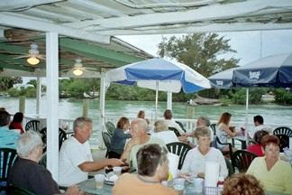 A dining area at Pops Sunset Grill Nokomis Florida