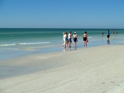 Walking and wading at Siesta Beach Sarasota Florida