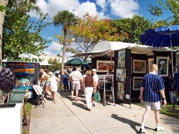 Folks browsinf at the St Armands Art festival Sarasota Florida