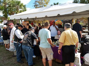 Cigar smokers gathering at one of the cigar vendor tents at the Tampa Cigar Fest